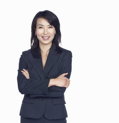 Portrait of beautiful business woman with hands folded over white background (3)