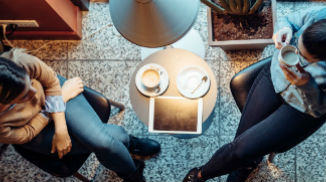 two-women-talking-over-coffee-326x182