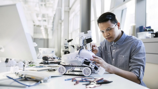 Hardware and infrastructure engineer focuses on assembling a robotic device.